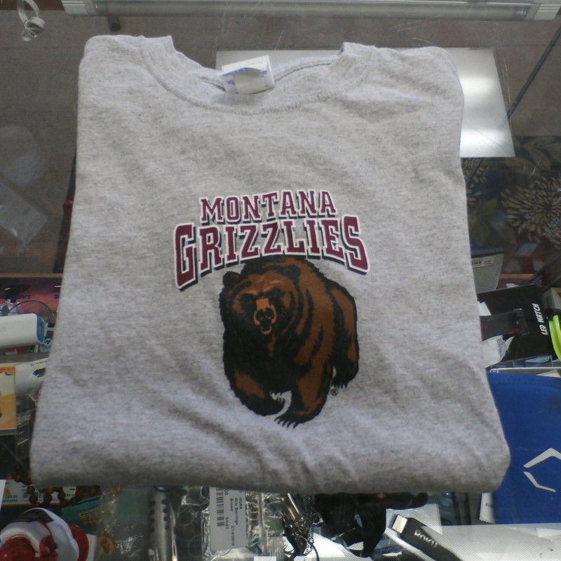 "Montana Grizzlies YOUTH t shirt gray size medium Gildan cotton blend #24773<br /> Rating: (see below) 3 - Good Condition<br /> Team: Montana Grizzlies<br /> Event: Logo Shirt<br /> Brand: Gildan<br /> Size: YOUTH- Medium  -  (measures: chest: 16""; length: 22"")<br /> Color: Gray<br /> Style: short sleeve; screen pressed<br /> Material: 90% Cotton 10% polyester;<br /> Condition:  3 - Good Condition;  wrinkled; very minimal wearing;<br /> Item #: 24773<br /> Shipping: FREE"