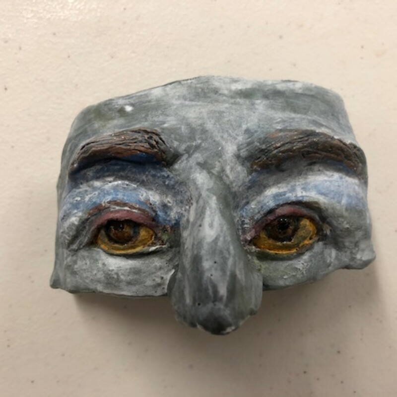 "Title: Stone Mask<br /> Artist: Fred Freeman<br /> Size: 4"" w x 3"" h<br /> Medium: Clay<br /> Description: A simple mask with stone look"