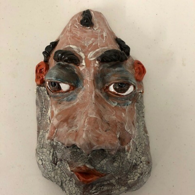 "Title: Milhouse, None<br /> Artist: Fred Freeman<br /> Size: 5"" w x 9"" h<br /> Medium: clay<br /> Description: A clay mask caricature"