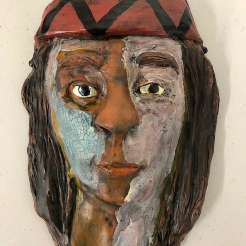 "Title: Native American Mask<br /> Artist: Fred Freeman<br /> Size: 5""w x 8""h<br /> Medium: Clay<br /> Description: A clay mask depicting an American Indian"