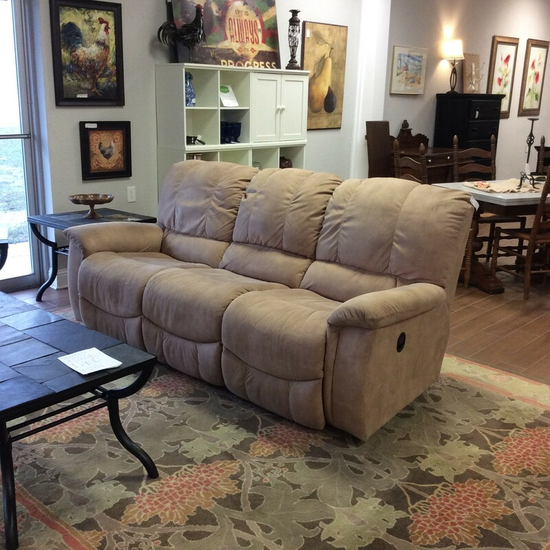 This LazyBoy reclining sofa has been upholstered in buckskin fabric. It has been treated with a fabric protector, has manual operation and there's a matching loveseat priced separately.
