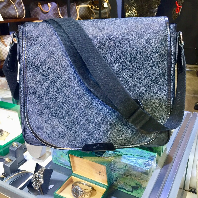 "Fresh and artistic, Louis Vuitton remains one of the world's most coveted symbols of status and sophistication. The Damier pattern was designed in 1888 and the Monogram, in 1896. Over a hundred years later, these remain two of the most recognizable prints in the world. Nicolas Ghesquière, previously of Balenciaga, is the artistic director of women's collections (2013). Virgil Abloh is the artistic director of the men's line since March 2018.<br /> <br /> Type of Material: Coated Canvas<br /> Color: Grey, Black<br /> Origin: France<br /> <br /> <br /> <br /> <br /> Width (at base): 12.25""<br /> Height: 10.25\""<br /> Depth: 3\""<br /> Shoulder Strap Drop: 16.75\""<br /> <br /> <br /> <br /> LV District MM Damier Gra, GRAY, Size: BAHH"