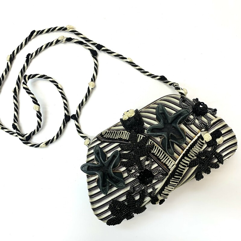 Mary Frances Handbag<br /> You'll be anything but a Wallflower with this beautifully embellished, floral crossbody clutch.
