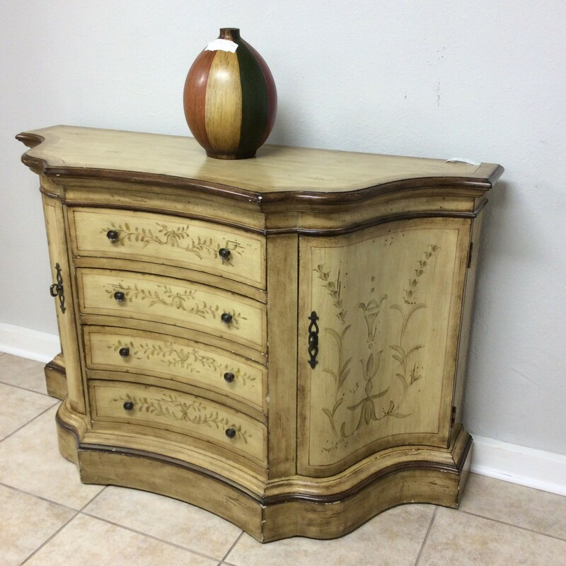 This chest by Pulaski is gorgeous and full of Old World Charm. Painted, antiqued and distressed, that feeling of timelessness abounds. It  features 2 cabinets (with a shelf), 4 drawers and vintagy hardware.