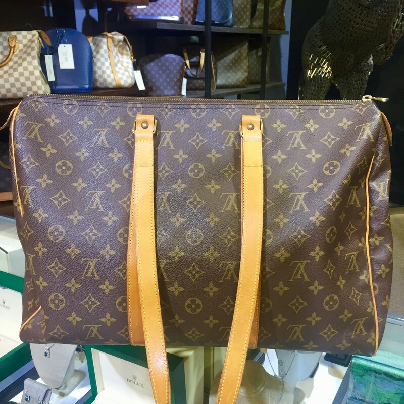 "Louis Vuitton Tote<br /> Vintage<br /> Brown Coated Canvas<br /> LV Monogram<br /> Brass Hardware<br /> Leather Trim<br /> Dual Shoulder Straps<br /> Canvas Lining & Single Interior Pocket<br /> Zip Closure at Top<br /> Details<br /> Shoulder Strap Drop: 13""<br /> Height: 13.75""<br /> Width: 17.5""<br /> Depth: 5.5""<br /> <br /> <br /> <br /> LV Sac Flanerie 40 Mono, BROWN, Size: MKH"