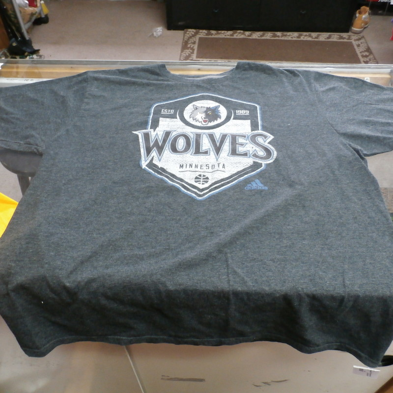 "Minnesota Timberwolves adidas Shirt Charcoal size XL cotton blend #25326<br /> Rating: (see below) 3- Good Condition<br /> Team: Minnesota Timberwolves<br /> Event: n/a<br /> Size: Men's- XL (Measured: Across chest 22.5"", length 29"")<br /> Measured: Armpit to armpit; shoulder to hem<br /> Color: Charcoal<br /> Style: short sleeve; screen pressed; climalite<br /> Material: 50% Cotton 50% polyester<br /> Condition: -3 Good Condition - wrinkled, minor pilling and fuzz; slight fading; stretched out from use; feels a little course; discolored slightly;<br /> Item #: 25326<br /> Shipping: FREE"