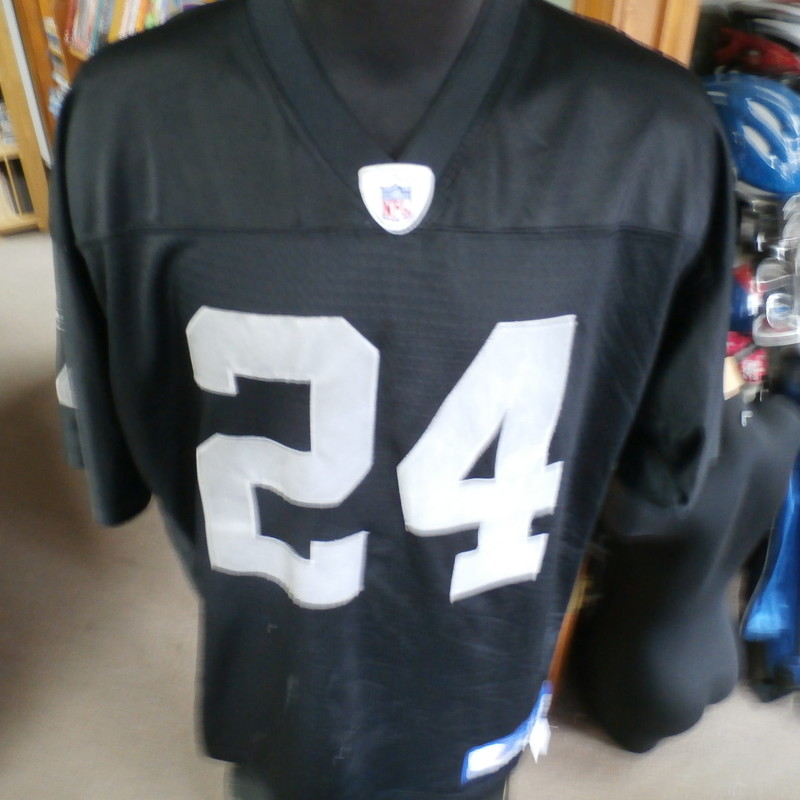 Title: Oakland Raiders Huff Reebok jersey XL #25427<br /> Our Clothes Rating: 4 - Fair Condition<br /> Brand: Reebok<br /> size: Men&#039;s XLarge- (Across chest: 26&quot; Length: 32&quot;)<br /> color: black<br /> Style: short sleeve; embroidered; pullover<br /> Condition: 4- Fair Condition - some pilling and fuzz; some fading and discoloration; wrinkles; some stretching and wear from washing and wearing; small snags throughout; small stain on collar embroidery; several white stains on front; no rips or tears<br /> Shipping: FREE<br /> Item #: 25427