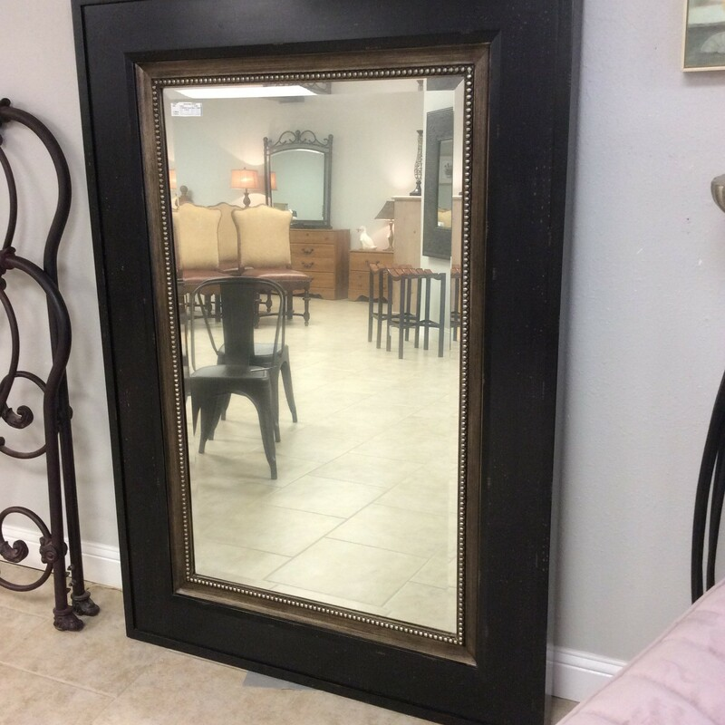 This handsome UTTERMOST mirror is ginormous! The solid wood frame is distressed and features a shabby black finish, with beautifully carved bronzy colored inner frame. The mirror itself is beveled and has a foggy/hazy look to it, which is intentional. ONLY $348.50!