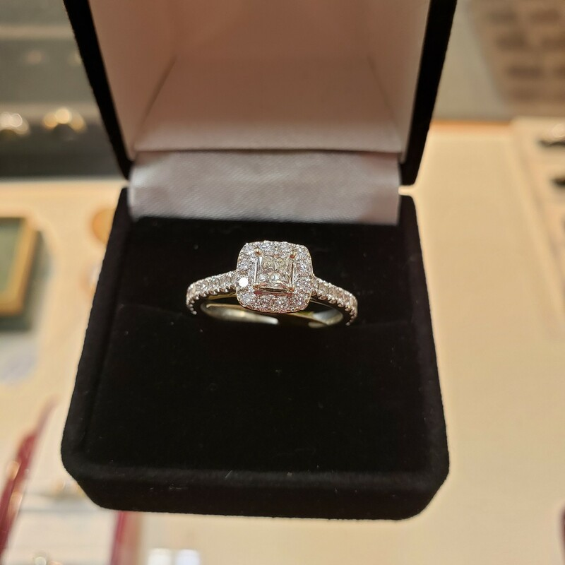 Neil Lane Halo 14k white gold  G/SI ring size 6.5<br /> <br /> Can be sized up or down for an additional fee<br /> Pictures do not do the jewelry justice.<br /> Photo ID required for pick up of online purchases. We will not ship jewelry purchases.<br /> <br /> All jewelry has been checked by a Certified Gemological Institute of America (GIA) Accredited Jewelry Professional (AJP) and/or appraised by a certified local jeweler.