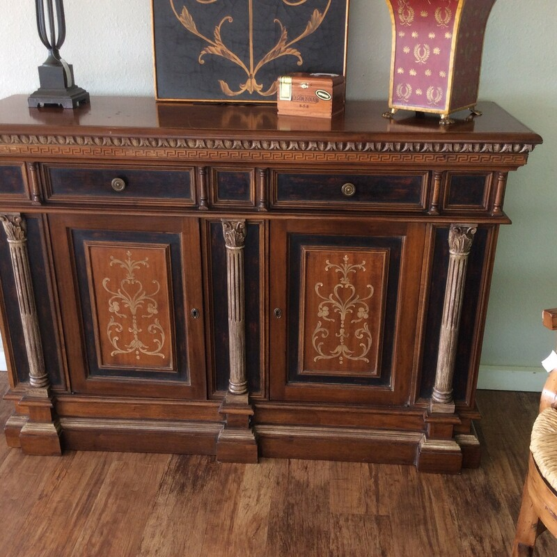 This gorgeous console was produced in Italy by a joint venture between HEKMAN and TURAZZA. It features solid wood construction and has a cherry finish, with black and gold painted accents. The lower cabinets lock, and there are 2 keys. They both have a single permanent shelf. Up top there are 2 roomy drawers and the entire piece is embellished with lovely carved details. ONLY $895!