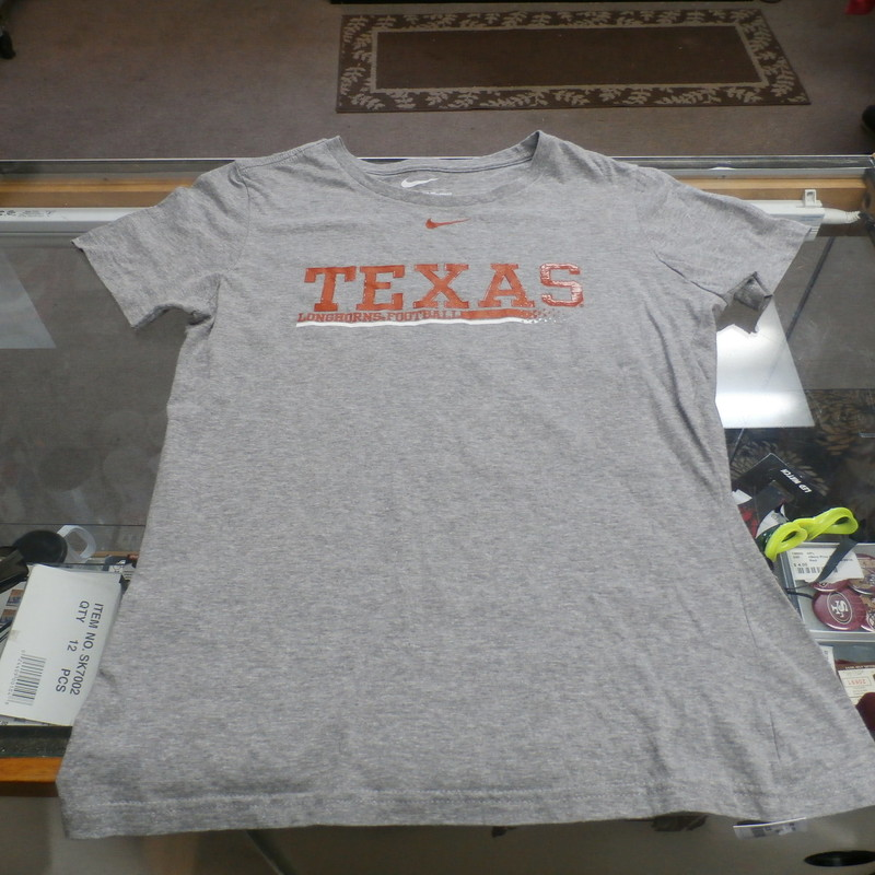 "Texas Longhorns Nike YOUTH Short Sleeve Shirt Large Gray Cotton Blend #25260<br /> Rating: (see below) 3- Good Condition<br /> Team: Texas Longhorns<br /> Player: N/A<br /> Brand: Nike<br /> Size: YOUTH - Large(12-14) (Measured: Across chest 18"", length 24"")<br /> Measured: Armpit to armpit; shoulder to hem<br /> Color: Gray<br /> Style: short sleeve; screen pressed; Slim Fit<br /> Material: 75% Cotton 25% Polyester<br /> Condition: 3 - Good Condition - wrinkled; material looks and feels good; stretched; pilling and fuzz; logo looks great; no stains rips or holes<br /> Item #: 25260<br /> Shipping: FREE"