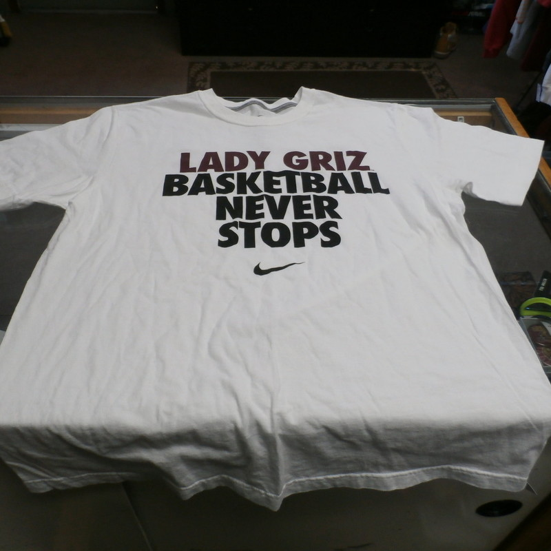 "Nike Lady Basketball Nike Men's Short Sleeve Shirt Large White Cotton #25328<br /> Rating: (see below) 3 - Good Condition<br /> Team: Montana Grizzlies<br /> Player: N/A<br /> Brand: Nike<br /> Size: Men's - Large(Measured: Across chest 21"", length 28"")<br /> Measured: Armpit to armpit; shoulder to hem<br /> Color: White<br /> Style: short sleeve; screen pressed logo; Just Do It<br /> Material: 100% Cotton<br /> Condition: 3 - Good Condition - wrinkled; material looks and feels good; pilling and fuzz; logo looks great; no stains rips or holes<br /> Item #:  25328<br /> Shipping: FREE"