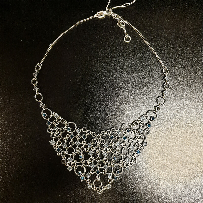 Beautiful Necklace.<br /> - Silver-tone frame<br /> - Blue crystals<br /> - Adjustable closure<br /> - Necklace length: 10 in.<br /> <br /> * Please note that these measurements and pictures are for reference only and may vary slightly from the original.