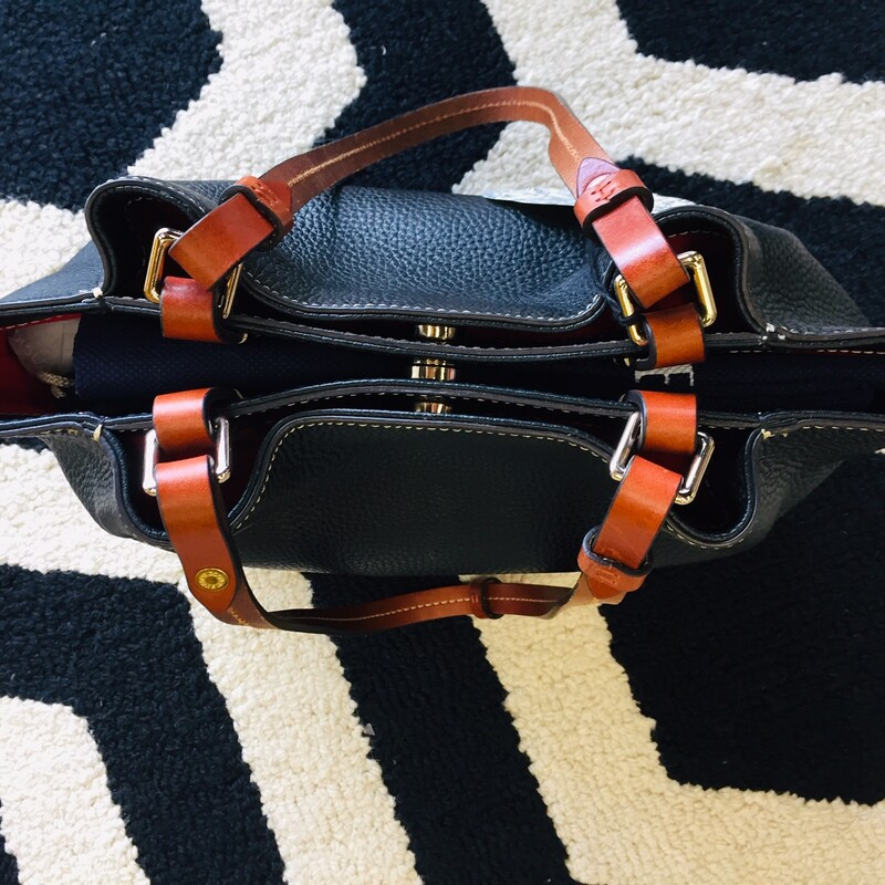 This item is a Dooney & Bourke all leather shoulder bag that features three wide sections with multiple pockets for storage. Great for daily use. Practically new with no signs of wear.