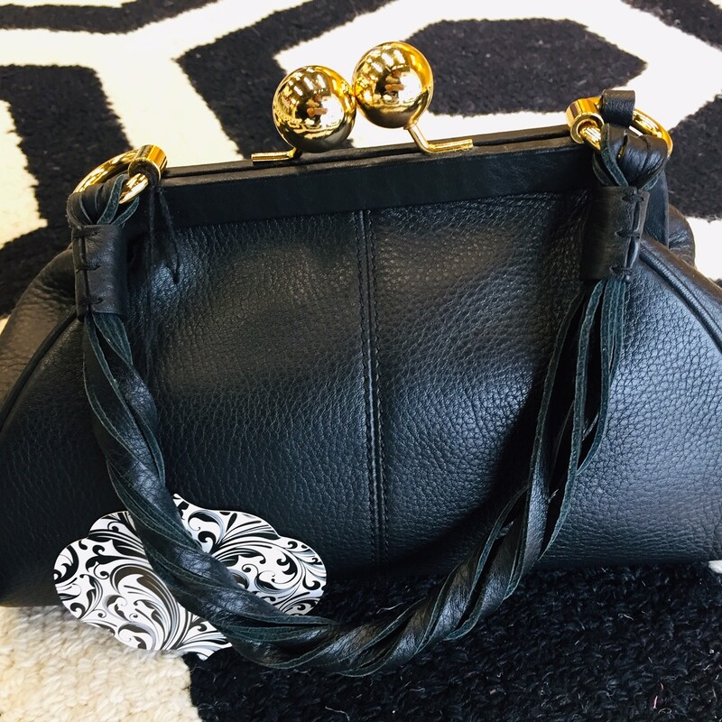 "This cute Kate Landry handbag is practically new with no signs of wear! Great for a ""going out"" bag or just to pair with a classy outfit. Gold hardware with black tassels!"