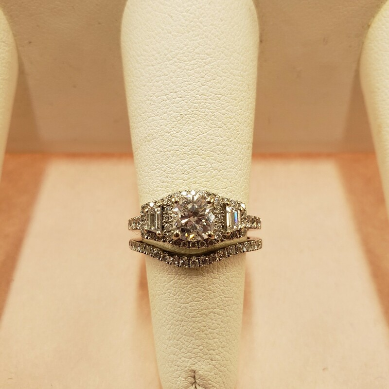 Gorgeous halo vintage style wedding set<br /> 1.01F/SI2 center cushion cut diamond GIA certified.<br /> .55cts of trapezoid and round cut side stones with G color and SI clarity.<br /> Matching band: .29cts G/SI pave set round diamonds.<br /> Size 6.5<br /> <br /> Can be sized up or down for an additional fee<br /> Pictures do not do the jewelry justice.<br /> Photo ID required for pick up of online purchases. We will not ship jewelry purchases.<br /> <br /> All jewelry has been checked by a Certified Gemological Institute of America (GIA) Accredited Jewelry Professional (AJP) and/or appraised by a certified local jeweler.