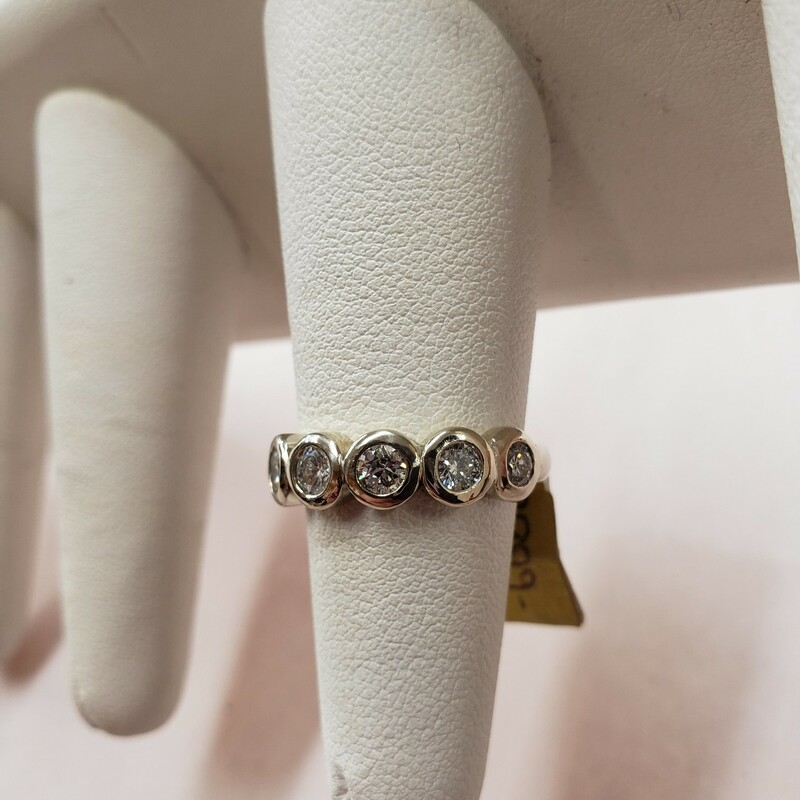 "1.08tw G-J 7 Stone Diamond Bezel Set Ring<br /> Affectionately nicknamed ""The Bubble Ring\""<br /> Size 6.75-7<br /> <br /> Can be sized up or down for an additional fee<br /> Pictures do not do the jewelry justice.<br /> Photo ID required for pick up of online purchases. We will not ship jewelry purchases.<br /> <br /> <br /> All jewelry has been checked by a Certified Gemological Institute of America (GIA) Accredited Jewelry Professional (AJP) and/or appraised by a certified local jeweler."