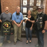 "Kevin ""K-MAC"" McMahon (right) and Mike ""Rocky"" Balboni (left) of the Combat Veterans Motorcycle Association CT Chapter 31-1, make a $2,000 donation to John Godburn and Melody Baber, to support service members struggling as a result of COVID 19."