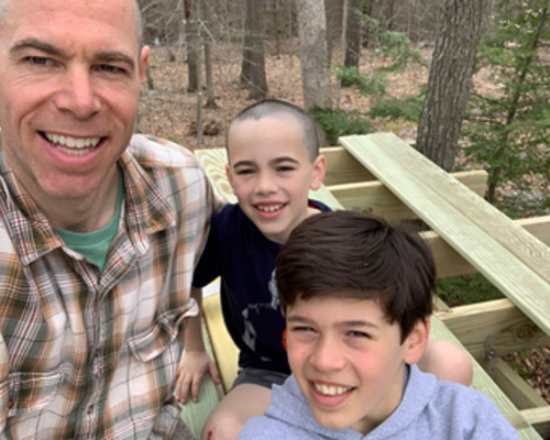 Attorney Parese recently taking a break from the law to build a tree fort with his boys.